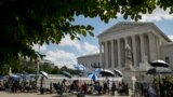 U.S. -- Supreme Court -- Members of the media set up outside the Supreme Court, Thursday, July 9, 2020, in Washington.