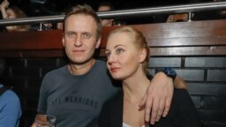 RUSSIA -- Russian opposition leader Aleksei Navalny (L) and his wife Yulia attend a concert of Russia's top rappers in support of rapper Husky, whose real name is Dmitry Kuznetsov, at a Moscow club, November 26, 2018