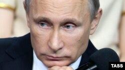 Russia -- President Vladimir Putin speaks during a MediaForum in St. Petersburg, April 24, 2014