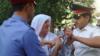 Мать обвиняемого в нападении на велотуристов пыталась себя поджечь у офиса ОБСЕ в Душанбе