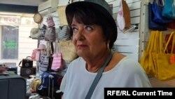 хозяйка маленького магазина Мари Клод