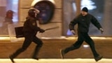 Belarus -- A riot policeman chases an opposition protester during a rally denouncing the results of presidential elections in central Minsk, 19Dec2010