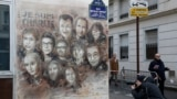 "The artwork of French street artist Christian Guemy aka ""C215"" depicting members of satirical magazine Charlie Hebdo is painted on a facade near the magazine's offices at Rue Nicolas Appert, on January 7, 2020 in Paris,"