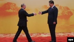 His new best friend. Vladimir Putin and Xi Jinping.