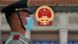 China Congress - A paramilitary policeman wearing a mask is seen before the closing session of the Chinese People's Political Consultative Conference (CPPCC) at the Great Hall of the People in Beijing Wednesday, May 27, 2020. (AP Photo/Andy Wong)