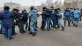 KAZAKHSTAN -- Police officers detain opposition supporters blocking a street during a protest after anti-government activist has died of heart problems in a police detention center, in Nur-Sultan, February 25, 2020