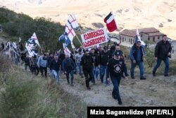 """Carrying a sign that reads """"Davit Gareji is Georgia,"""" the Georgian March, a group of ultranationalists that shares Kremlin suspicions of the West, staged a rally at the monastery complex on October 9, 2020."""