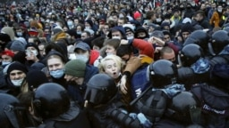 RUSSIA – People clash with police during a protest against the jailing of opposition leader Alexei Navalny in St.Petersburg, Jan. 23, 2021