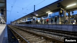Germany - Passengers wait for their train at the train station in Munich-Pasing during a strike of train drivers' union GDL November 7, 2014