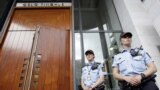 Norway -- Police officers guard the court entrance in Oslo, Norway, Monday, July 25, 2011