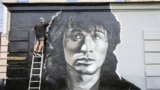 Russia -- A graffiti depictyng a portrait of Viktor Tsoi is seen in the center of Str. Petersburg, August 14, 2014