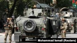 Афганские силы безопасности после теракта в Кабуле 9 мая