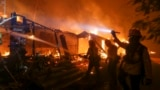 U.S.-- Firefighters battle the Woolsey Fire burning a home in Malibu, Calif., Friday, Nov. 9, 2018