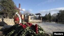 Безымянная могила, в которой предположительно похоронен Виктор Янукович-младший, фото Reuters