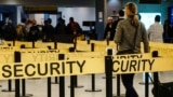 U.S. -- Passengers make their way through a security checkpoint at JFK International Airport in New York in this file photo taken October 11, 2014.