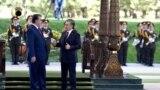 UZBEKISTAN -- Uzbek President Shavkat Mirziyoev (R) and his Tajik counterpart Emomali Rahmon attend a welcoming ceremony in Tashkent, August 17, 2018