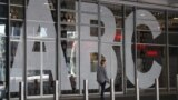 AUSTRALIA -- A woman walks past Australia's public broadcaster ABC's head office building in Sydney, September 27, 2018