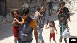 Раненые во время атаки в городе Алеппо 25 июля 2016 года. Фото – иллюстративное