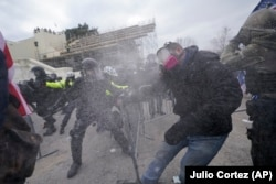 Supporters of Republican President Donald Trump try to break through a police barrier on January 6, 2021 at the U.S. Capitol, where thousands of people gathered to contest Democratic presidential candidate Joe Biden's win of the 2020 U.S. presidential election.