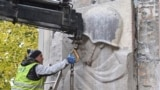 POLAND -- Workers dismantle one of the best-known monuments expressing gratitude to the Soviet Red Army for freeing Poland from the Nazi German occupation, amid democratic Poland's drive to move communist-era symbols to a museum, in Skaryszewski Park in W