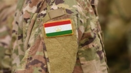 Tajikistan flag on soldiers arm (collage).