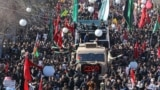 IRAN -- Iranian mourners gather around a vehicle carrying the coffin of slain top general Qasem Soleimani during the final stage of funeral processions, in his hometown Kerman, January 7, 2020