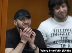 Khamzat Bakhayev (left) next to Temerlan Eskerkhanov in the Moscow District Military Court on their day of sentencing, July 13, 2017.