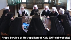 Top figures in Ukraine's new Orthodox Church meet in a synod in Kyiv on May 24, including Patriarch Filaret (left) and Metropolitan Epifaniy (center).