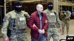Travel blogger Aleksandr Lapshin is met by Azerbaijani security offers upon his landing in Baku after being extradited from Belarus in 2017.