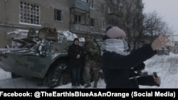 Still from Iryna Tsilyk's The Earth Is As Blue As An Orange (2020)