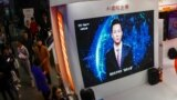 China -- In this photo taken on November 7, 2018 a screen shows an artificial intelligence (AI) news anchor introducing himself at the Light of Internet Expo during the 5th World Internet Conference in Wuzhen in China's eastern Zhejiang province. - China'