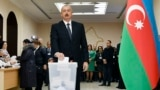 Azerbaijani President Ilham Aliyev casts his ballot at a Baku polling station during Azerbaijan's February 9, 2020 parliamentary elections.