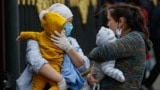 RUSSIA -- Kyrgyz women with their babies speak to each other in front of Kyrgyzstan embassy in Moscow, May 14, 2020