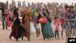 Сирийские беженцы эвакуируются из страны