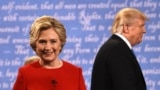 U.S. -- Democratic nominee Hillary Clinton (L) and Republican nominee Donald Trump leave the stage after the first presidential debate at Hofstra University in Hempstead, New York, September 26, 2016
