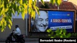 Один из плакатов в рамках антисоровской кампании, которую ведет правительство Венгрии