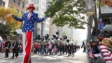 New York, U.S. - A man dressed as Uncle Sam reacts to a member of the crowd during the Veterans Day Parade in Manhattan