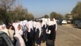Kazakhstan - Schoolgirls, who wear shawl, stay in front of school.Ferdausi village, Turkestan region, 5September2018