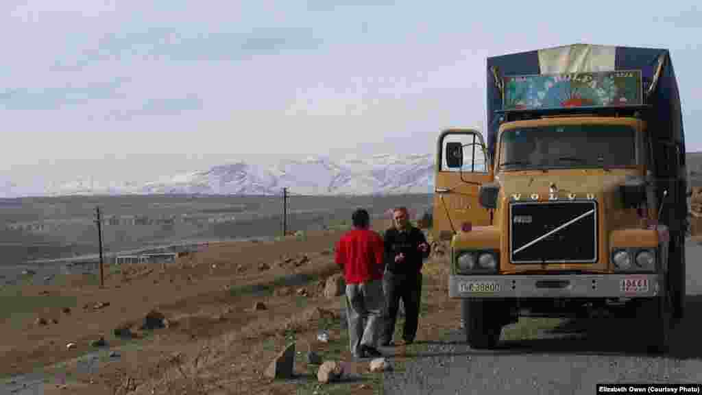 An ethnic Armenian truck driver from nearby Iran requests directions in 2006 from a taxi driver in the Lachin corridor, a then-Armenian-controlled strip of territory that connects Nagorno Karabakh to Armenia. On December 1, 2020, Azerbaijan will regain formal control of the Lachin district, but, under the new Armenian, Azerbaijani, and Russian peace deal,  peacekeeping troops from Russia guard the Lachin corridor.