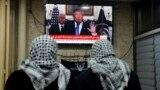 ISRAEL -- Palestinian men watch an address given by U.S. President Donald Trump at a cafe in Jerusalem, December 6, 2017
