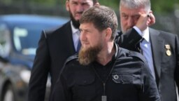 RUSSIA – MOSCOW, MAY 7, 2018: Ramzan Kadyrov (front), head of Russia's Chechen Republic, Chechen Parliament Chairman Magomed Daudov (L), and State Duma member Adam Delimkhanov (R) arrive for an inauguration of Vladimir Putin as President of Russia at the