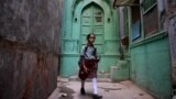 INDIA -- An Indian school girl walks in an alley in the old quarters of New Delhi, November 28, 2018