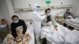 CHINA -- A doctor checks the conditions of a patient at Jinyintan Hospital, designated for critical COVID-19 patients, in Wuhan, Hubei province, February 13, 2020