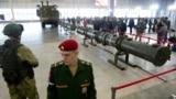 RUSSIA -- Russian military officers stand by as the 9M729, center, its launcher, left, and the 9M728, right, land-based cruise missiles are displayed in Kubinka outside Moscow, Russia, Wednesday, Jan. 23, 2019