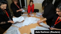 Members of an election commission count ballots at a Baku polling station after early parliamentary elections in Azerbaijan on February 9, 2020.