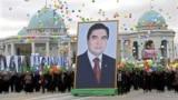 TURKMENISTAN -- People carry a picture of Turkmen President Gurbanguly Berdymukhammedov to mark Turkmenistan's Independence Day in Ashgabat on October 27, 2009.