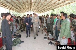 Afghan Ambassador to Tajikistan Muhammad Zaher Aghbar visits a refugee camp for Afghan soldiers in Tajikistan. (Credit: Facebook/Amb. Muhammad Zaher Aghbar )