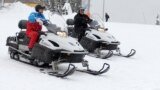 RUSSIA -- Russian President Vladimir Putin and his Belarusian counterpart Alyaksandr Lukashenka ride snowmobiles following their talks in Sochi, February 22, 2021