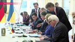 О чем договорились три президента и канцлер в Париже