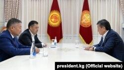 President Sooronbai Jeenbekov (right) meets with Kyrgyzstan's new parliamentary speaker, Kanat Isaev (front left), and prime minister, Sadyr Japarov, in Bishkek on October 14, 2020.